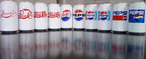 A series of cans showing Pepsi logos throughout time